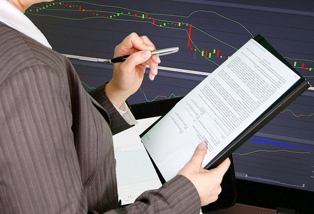 A picture of an accountant performing complete audit services