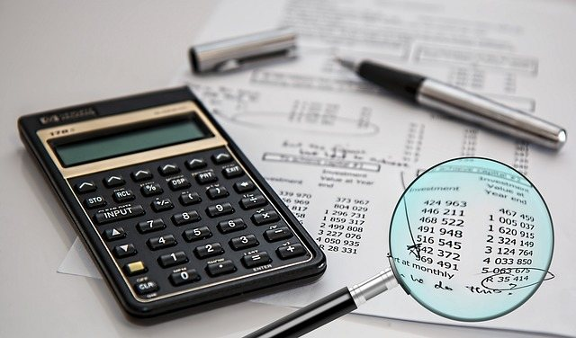 A picture of an accountant performing audit services